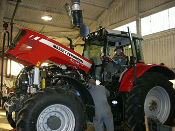 MF 6490 tractor being serviced at Chandlers
